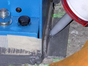Jacking bolts used to lift equipment while Belzona is applied